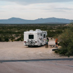 First time RV campers on a dirt road.