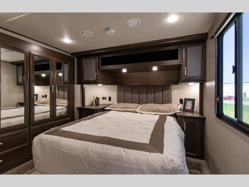 bedroom in Momentum G-Class Toy Hauler Fifth Wheel