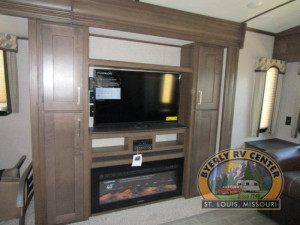 "The Keystone Laredo 330RL features opposing slides and a 40"" TV located above the fireplace."