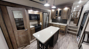 The large island kitchen gives you the space to cook and the rear den gives you space to entertain in the Coachmen Chaparral 381RD at Byerly RV