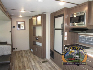 The Keystone Hideout 338LHS travel trailer is loaded with queen bedroom, bunk room with half bath, and more.