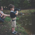 Outdoor fishing man with kids