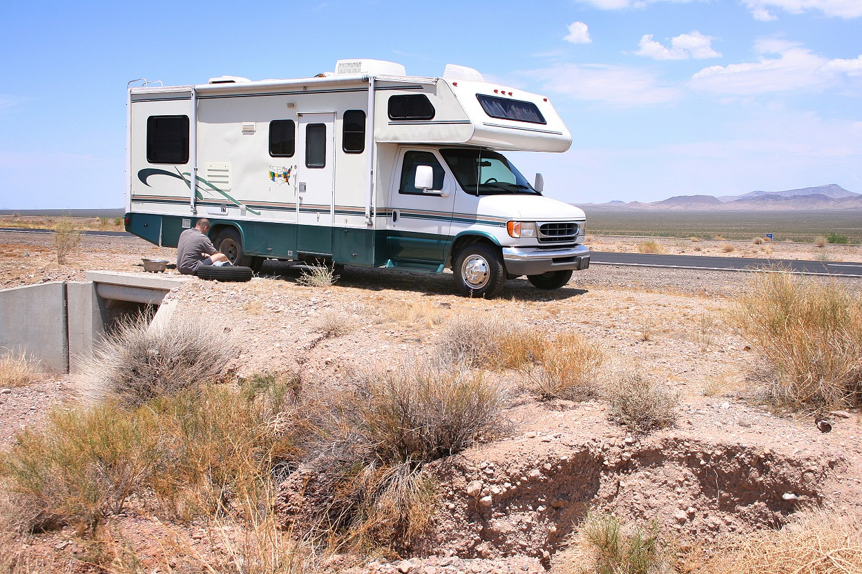 Motorhome RV with Flat in Desert