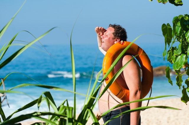 man on hot beach