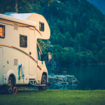 Camper Camping at the Glacier Lake. Camper Van Vacation.