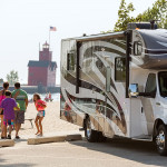 Family RVing at beach