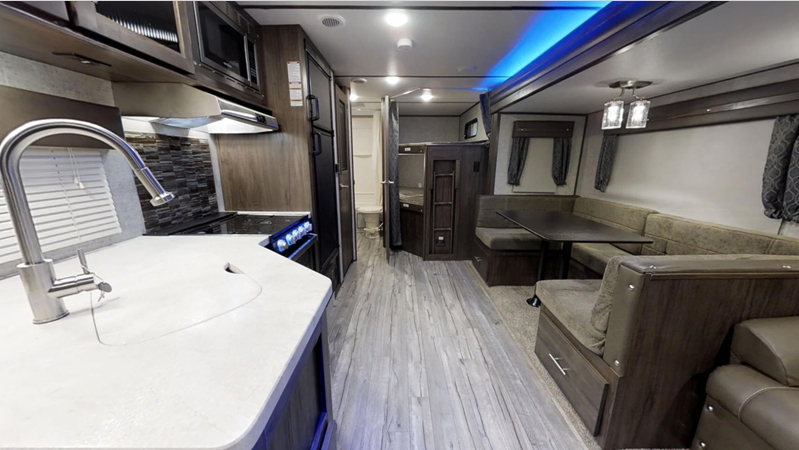 interior view of kitchen and dining alpha wolf travel trailer