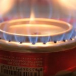 how to build a coke can stove, picture of a coke can stove on lit to cook