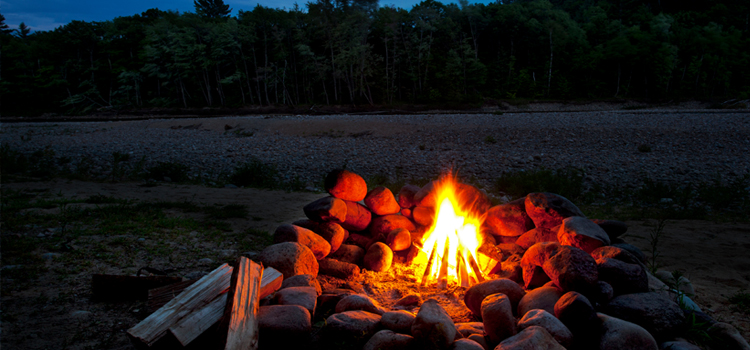 3 camping hacks, picture of a campfire with the trees and sky in the background, camping hacks
