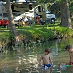 amazing ways to save on camping in ohio, picture of people camping in a rv in ohio