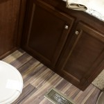how to organize your rv bathroom, picture of a rv bathroom, picture with a rv toilet shower and sink bathroom, organize your rv bathroom tips