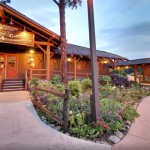 camping at disney, picture of Disney's Fort Wilderness Resort welcome building log cabin