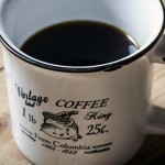 coffee while camping, picture of coffee in a cup sitting on a wooden table