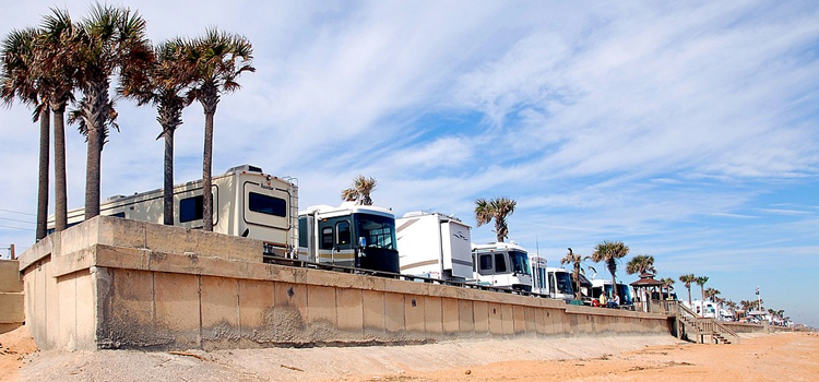summer camping hacks, picture of rvs in a line with palm trees to the left