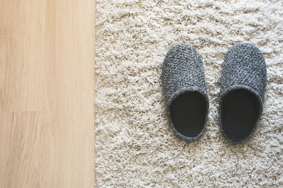 gray slippers on rug