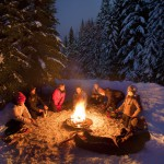 family enjoying campfire in winter