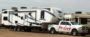 rv city truck towing a Seismic