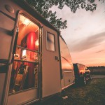 Travel Trailer Camping. RV Trip Theme. Evening in RV . Vintage Color Grading.