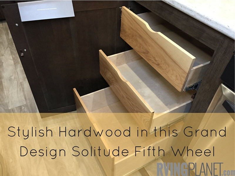 Stylish Hardwood in this Grand Design Solitude Fifth Wheel