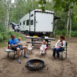 Family RVing in forest