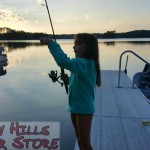 Kid fishing sundown