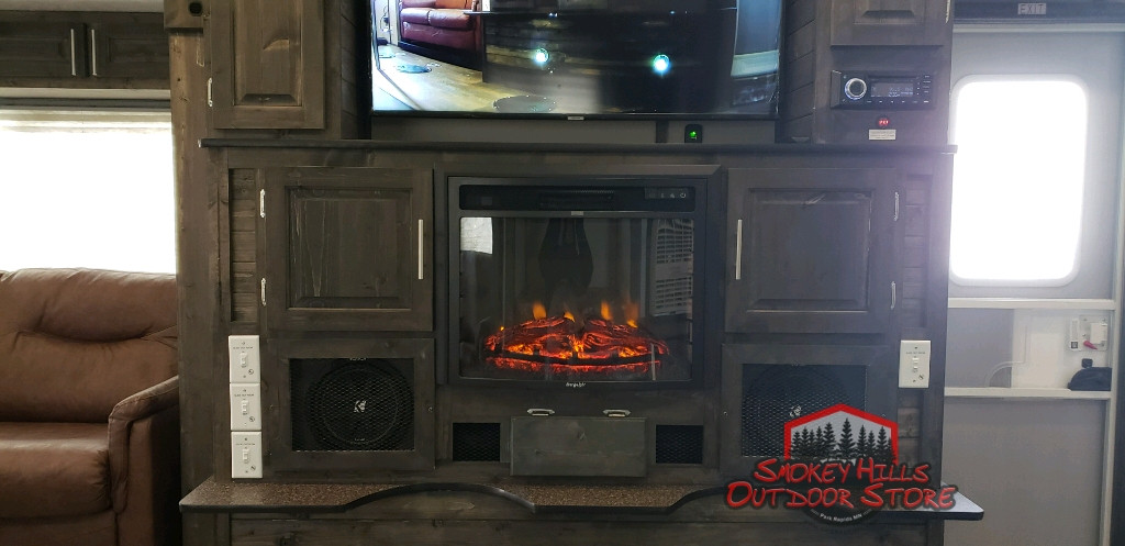 Custom Media Center with subwoofers and two amps in Ice Castle Fish House