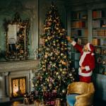 santa decorating tree